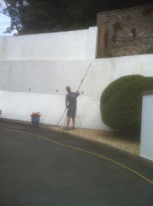 Pressure washing a low wall